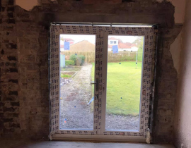 Cut-out-existing-window-fitted-new-concrete-lintels-and-French-Doors-Part-2